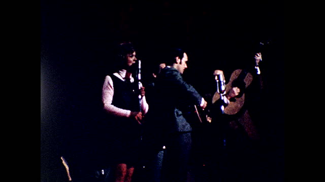 man in blue suit and glasses singing on stage with guitar; different views of another man singing on stage; woman singing behind the microphone as... - 1960 1969 stock videos & royalty-free footage