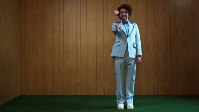 ws man in blue suit holding carnation, atlanta, georgia, usa - full length stock-videos und b-roll-filmmaterial