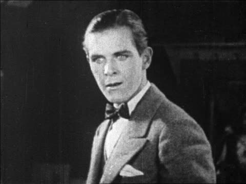 b/w 1925 man in bowtie staring off screen (donald keith?) / feature - anno 1925 video stock e b–roll