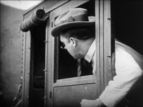 b/w 1924 man in bowtie with pincenez clinging to window of stagecoach / feature - 1924 stock videos & royalty-free footage