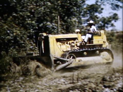 1954 montage man in bulldozer demolishing trees, river at sunset / brazil / audio - 1954 stock videos & royalty-free footage