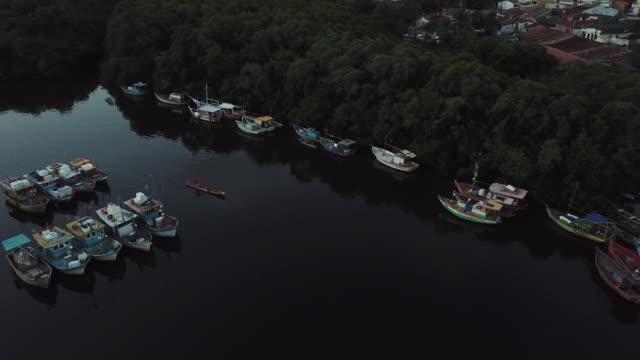 man in canoe at porto seguro harbor, bahia state, brazil - porto seguro stock videos & royalty-free footage
