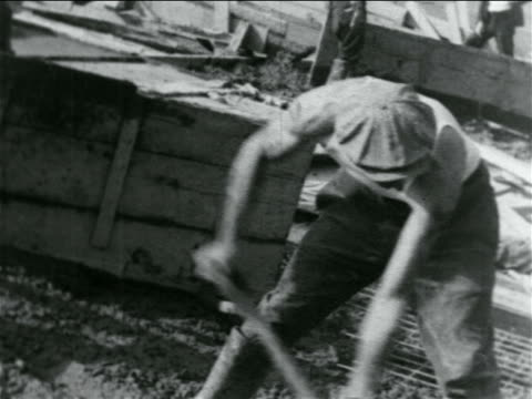 man in cap laying cement with shovel on hillside in wpa construction project / documentary - one mid adult man only stock videos & royalty-free footage