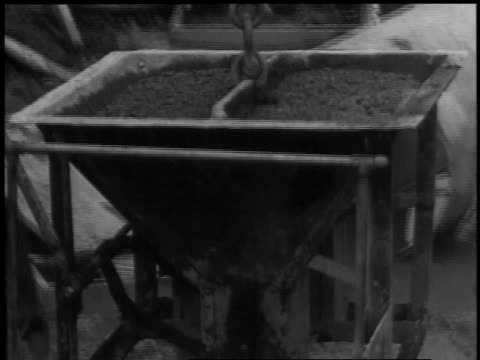 1941 montage man in construction crane delivering container of concrete to work site / washington d.c., united states - cement mixer stock videos and b-roll footage