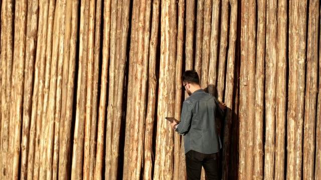 Man in counts wood lumber