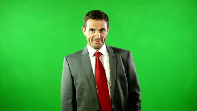Man in different uniforms in front of Green screen