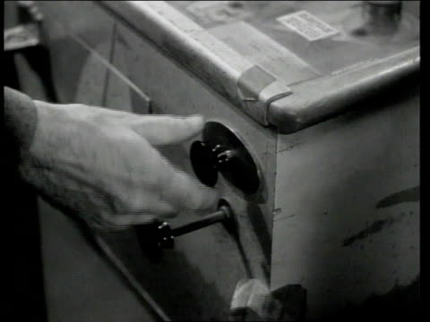 1948 montage man in drug store carefully preparing pinball machine before playing it / united states - pinball machine stock videos & royalty-free footage