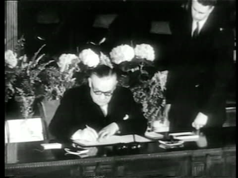 b/w 1949 man in eyeglasses sitting at large desk signing nato pact at united nations / documentary - 1949 stock videos & royalty-free footage