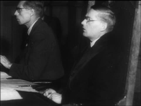 b/w 1945 man in eyeglasses talking in courtroom during war crimes trial / newsreel - war crimes trial stock videos and b-roll footage