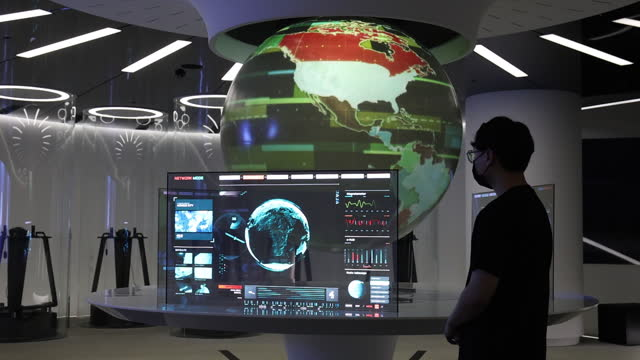 man in face masks lookis at a virtual globe and digital display at the t.um showroom in the sk telecom co. headquarters in seoul, south korea, on... - futuristic stock videos & royalty-free footage