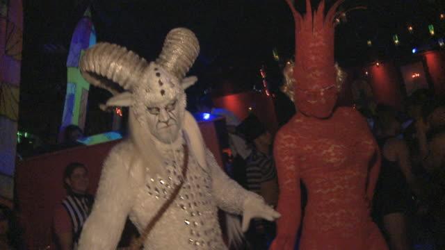 ms tu man in faun costume dancing with man in lady ga ga costume in night club / miami, florida, usa - animal costume stock videos & royalty-free footage