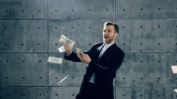 Man in formal suit dancing and throwing money