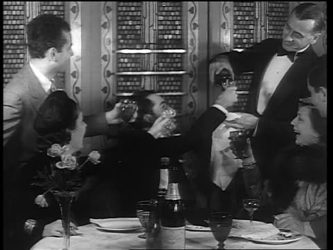 man in formalwear pouring drinks for people sitting at table / end of prohibition - 1933 stock videos & royalty-free footage