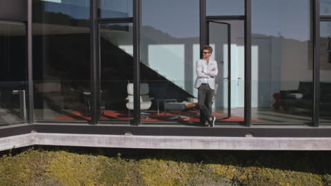 man in front of luxury building - mansion stock videos & royalty-free footage