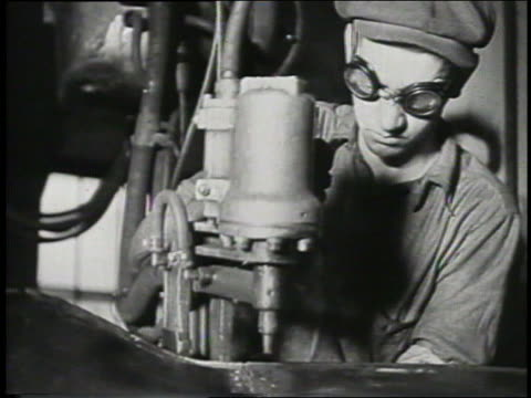 b/w 1932 man in goggles uses power tool on ford factory assembly line - safety glasses stock videos & royalty-free footage