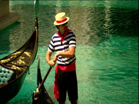 Man in gondola wearing traditional Italian outfit Venice Resort Las Vegas