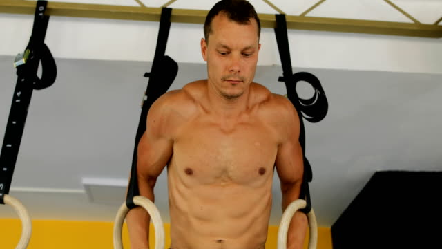 man in gym exercising with gymnastic rings - gymnastic rings stock videos & royalty-free footage