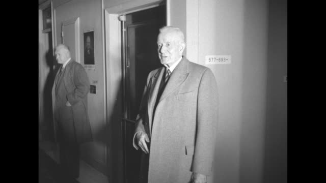VS man in hallways and departure with UN Secretary General Trygve Lie escorted to car / PresidentElect Dwight D Eisenhower has arrived at steps of...
