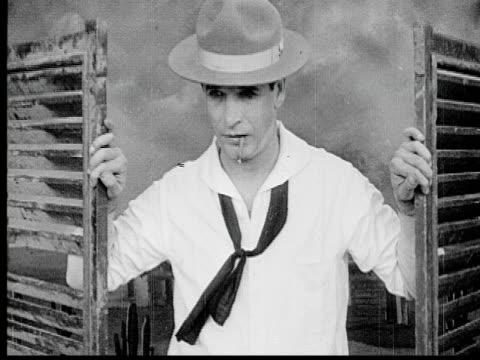 b/w 1920 ms man in hat standing in saloon doorway - nur männer über 40 stock-videos und b-roll-filmmaterial