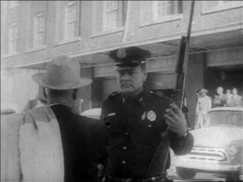 man in hat talking to policeman with gun looking up / kennedy assassination / dallas - assassination of john f. kennedy stock videos & royalty-free footage