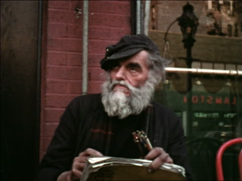 1969 man in hat with grey beard sitting outdoors drawing with pencils / greenwich village, nyc - greenwich village stock videos & royalty-free footage