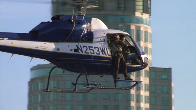 ms ts man in helicopter looking from object - helicopter stock videos & royalty-free footage