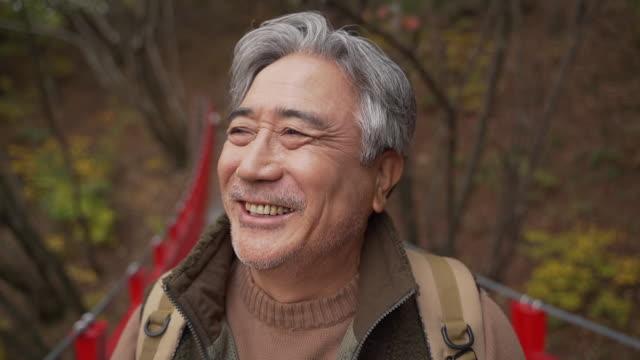 a man in his 60s having a big smile / yangpyeong-gun, gyeonggi-do, south korea - human nose stock videos & royalty-free footage