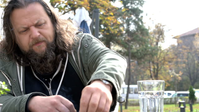 man in his mid-thirties waiting at the café in the city - restlessness stock videos and b-roll footage
