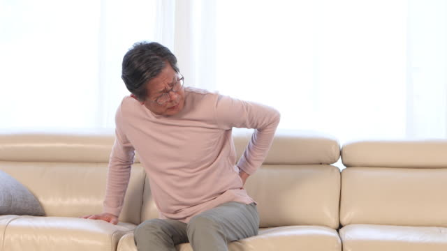 man in his sixties suffering from backache - cramp stock videos & royalty-free footage