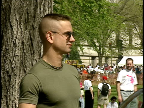Man in Holding an 'End Military Ban' Sign at Gay Right Rally in Washington DC