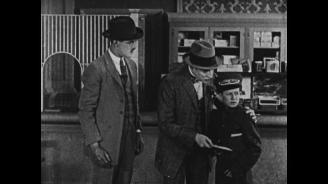 1924 man in hotel summons bellboy and sends him off with a message - 1924年点の映像素材/bロール