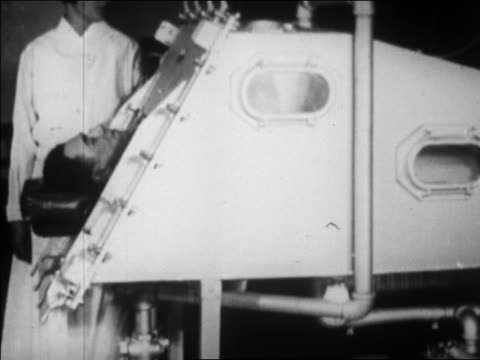 man in iron lung in hospital / nurse stands nearby / boston / newsreel - 1920 1929 video stock e b–roll