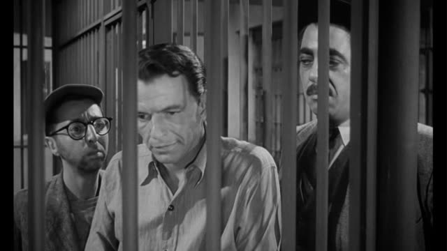 vídeos de stock e filmes b-roll de 1955 man (frank sinatra) in jail is tempted with help from gangster - gânguester