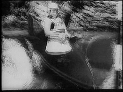 b/w 1966 man in kayak in slalom competition on rapids / ruhr river germany / newsreel - ruhr video stock e b–roll