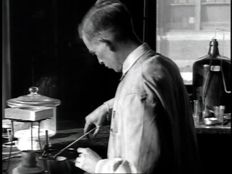 1926 montage man in laboratory working with burner and adjusting wick in kerosene lantern / united states - 1926 stock videos & royalty-free footage