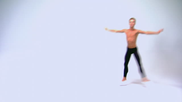 man in leotard pant leaping across studio - ballet dancing stock videos & royalty-free footage