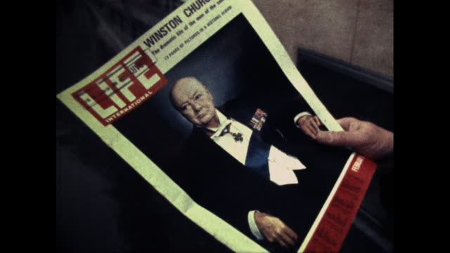 a man in london reading a magazine which has a cover of winston churchill - magazine stock videos & royalty-free footage