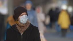 Man in mask coronavirus 2019-ncov. Corona virus covid-19. Environment pollution.