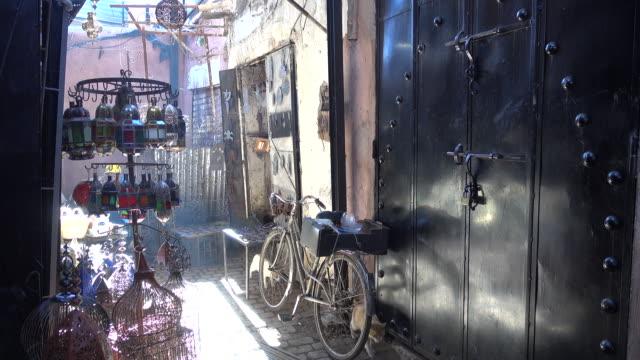 Man in Morrocan djellaba walks through market