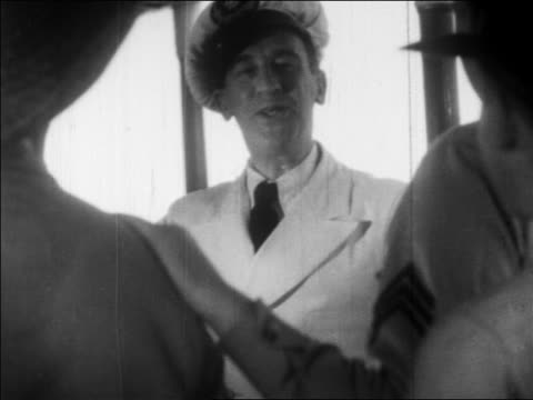 b/w 1932 man in naval hat smiling + talking to men / feature - 1932 stock videos and b-roll footage