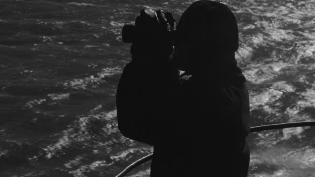 cu man in navy lookout from submarine - binoculars stock videos & royalty-free footage