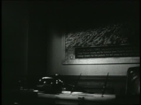 b/w 1949 man in office picking up telephone - 1949 bildbanksvideor och videomaterial från bakom kulisserna
