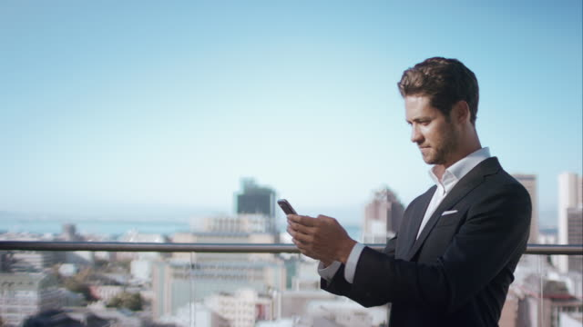 Man in penthouse using his smartphone