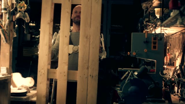 man in powered exoskeleton in workshop - exoskeleton stock videos & royalty-free footage