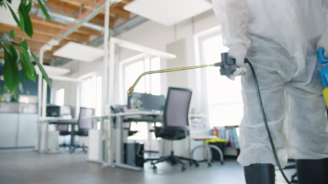man in ppe suit disinfecting office premises - rubbing alcohol stock videos & royalty-free footage