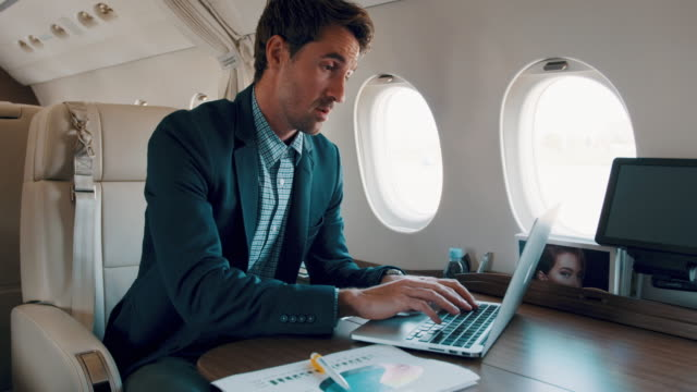 man in private jet airplane - wealth stock videos & royalty-free footage