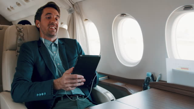 man in private jet airplane - business travel stock videos & royalty-free footage