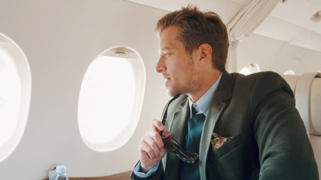 man in private jet airplane - businesswear stock videos & royalty-free footage