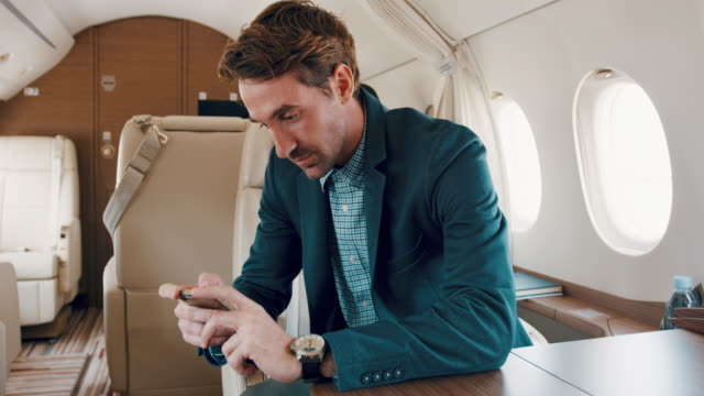man in private jet airplane - wrist watch stock videos & royalty-free footage