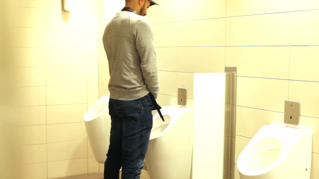 man in public toilet - beard stock videos and b-roll footage